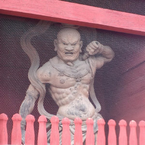 A wrathful protector deity (Kongôrikishi) in front a Buddhist temple in Japan. (See photo credit)